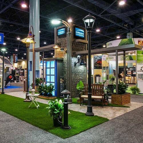 AAL lighting's trade show booth with lights and chairs