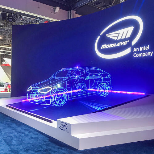 Mobileye booth with 60 foot screen and led lit car