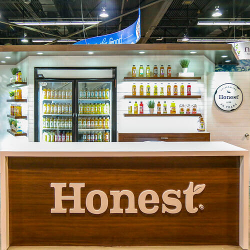 honest tea trade show booth with backlit products highlighting their teas and juices