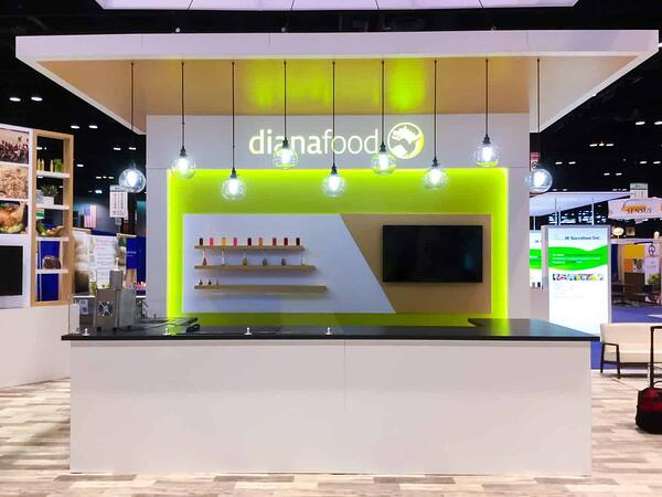 Dianafood trade show booth serving bar with overhanging hip lights