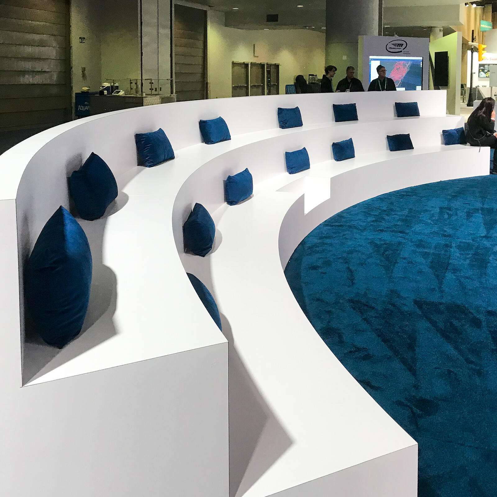 white sitting area with blue cushions to match blue floor at ces 2020 mobileye