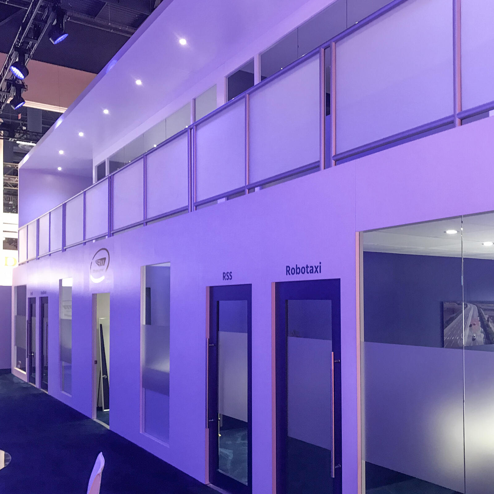 two story meeting space with multiple private rooms at ces floor